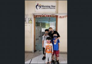 Ms Ivy Koh with her three sons outside Morning Star Community Services @ Primavera Centre, which offers an evening support programme for children. PHOTO: MORNING STAR COMMUNITY SERVICES