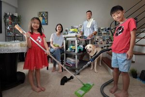 Mr Norman Ng and Ms Alice Wong got their kids, Lincoln and Paige (all above), to help tidy up and mop and vacuum the floor together with them. ST PHOTO: ALPHONSUS CHERN